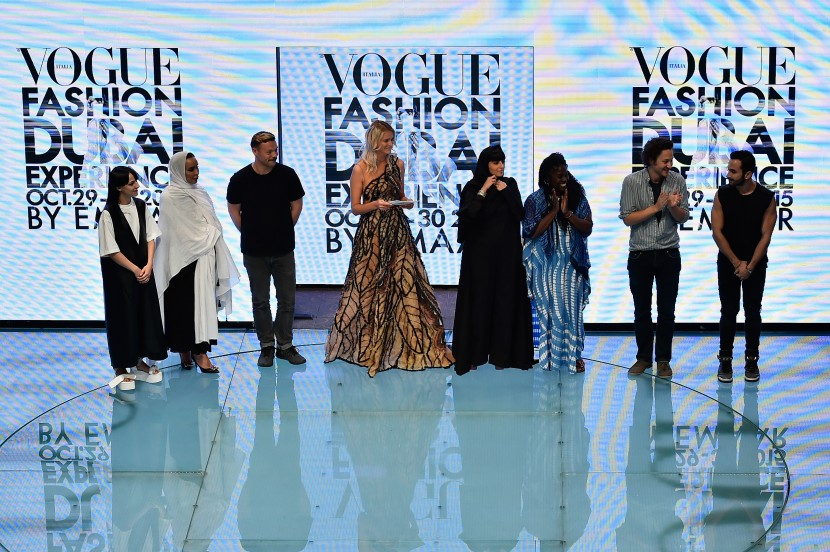 DUBAI, UNITED ARAB EMIRATES - OCTOBER 29:  (L-R) Melitta Baumeister, a designer of the label The Kayys, Lee Wood, Carmen Kass, Reem Al Kanhal, Abrima Erwiah, Arthur Arbesser and Krikor Jabotain stand on stage after the Talents Fashion show during the Vogue Fashion Dubai Experience 2015 at The Dubai Mall on October 29, 2015 in Dubai, United Arab Emirates.  (Photo by Cedric Ribeiro/Getty Images for Vogue and The Dubai Mall) *** Local Caption *** Melitta Baumeister;Lee Wood;Carmen Kass;Reem Al Kanhal;Abrima Erwiah;Arthur Arbesser;Krikor Jabotain