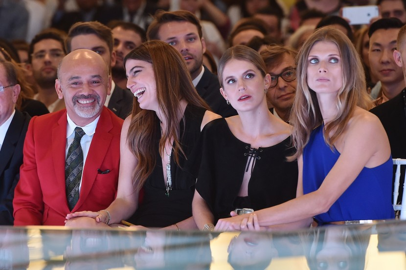 DUBAI, UNITED ARAB EMIRATES - OCTOBER 29:  (L-R) Designer Christian Louboutin, Bianca Brandolini, Eugenie Niarchos and Malgosia Bela  attend the Talents Fashion show during the Vogue Fashion Dubai Experience 2015 at The Dubai Mall on October 29, 2015 in Dubai, United Arab Emirates.  (Photo by Jacopo Raule/Getty Images for Vogue and The Dubai Mall) *** Local Caption *** Christian Louboutin;Bianca Brandolini;Eugenie Niarchos;Malgosia Bela